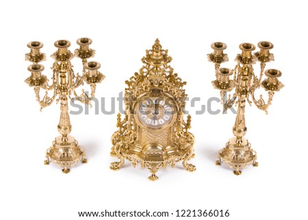 Vintage watch with two candelabra on white background #1221366016