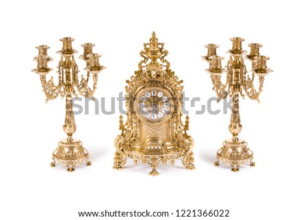 Vintage watch with two candelabra on white background #1221366022