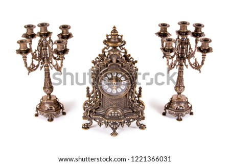 Vintage watch with two candelabra on white background #1221366031