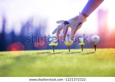 concept of golf ball invitation on incoming year 2019, prepare by hand of woman on tee off,  ready to hit away the new year success on fairway, Happy new year and merry christmas on golf course #1221372322