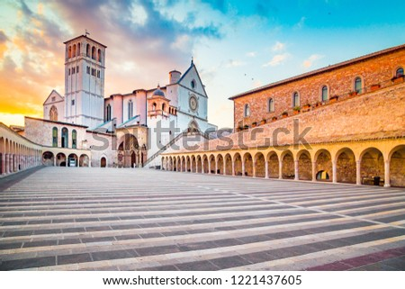Famous Basilica of St. Francis of Assisi (Basilica Papale di San Francesco) with Lower Plaza at sunset in Assisi, Umbria, Italy #1221437605
