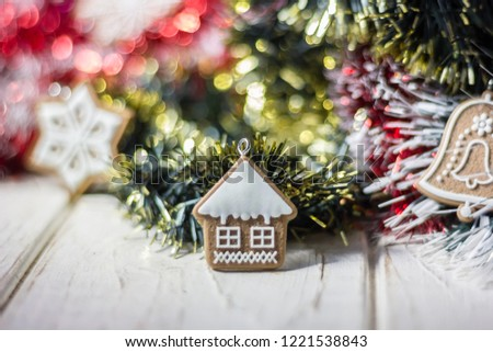 Christmas decoration - home on christmas tree over white wooden background. #1221538843