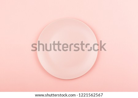 Empty pink plate on the pastel pink background. Flat lay, top view. #1221562567