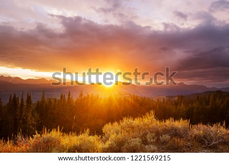 Scenic Sunset in the mountains in fall season #1221569215