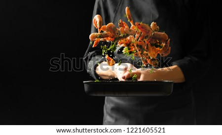 Professional chef prepares shrimps with greens. Cooking seafood, healthy vegetarian food, and food on a dark background. Horizontal view. #1221605521
