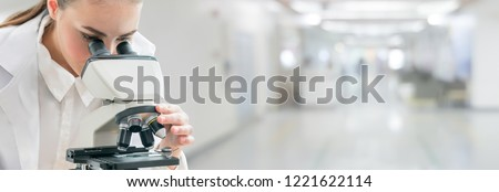 Scientist researcher using microscope in laboratory. Medical healthcare technology and pharmaceutical research and development concept. #1221622114