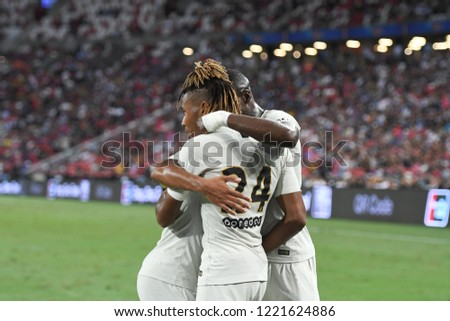 Kallang-Singapore-30Jul2018:Christopher nkunku #24 player of PSG congratulation for goal during icc2018 between Atletico madrid against at paris saint-german at national stadium,singapore #1221624886