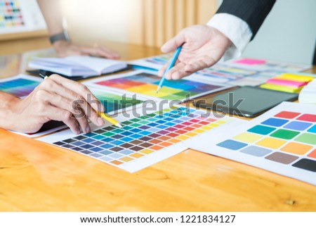 Creative Graphic designer at work. Color swatch samples palette in studio modern office, interior design, renovation and technology concept #1221834127
