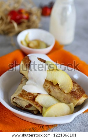 stuffed pancakes with caramelized apples and vanilla sauce #1221866101