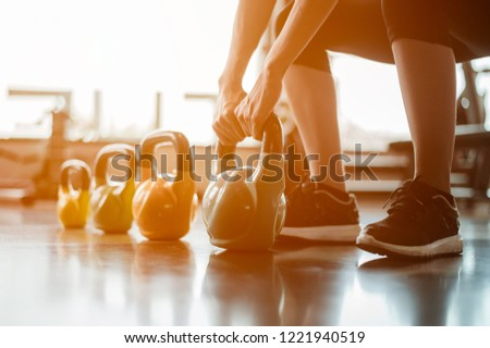 Exercising with a kettlebell at the gym.  #1221940519