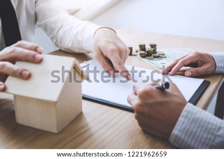 Business Signing a Contract Buy - sell house, insurance agent analyzing about home investment loan Real Estate, Concept mortgage loan approval. #1221962659