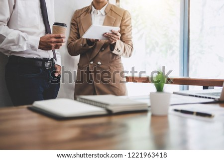 Business team colleague working and conference with new startup project plan and discussion information for financial strategy with digital tablet, results of their successful teamwork. #1221963418