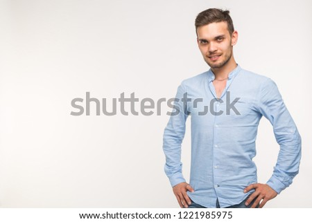 Self-confidence, business and people concept - Successful handsome man with smile on white background with copy space #1221985975