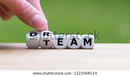 """Hand is turning a dice and changes the word """"dream"""" to """"team"""" #1222068514"""