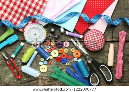 Sewing accessories on grey wooden table #1222090777