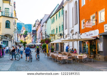 FUSSEN, GERMANY - AUG 28, 2018: Street cafe in the Fussen old town city centre. Fussen is a small town in Bavaria, Germany. #1222189351