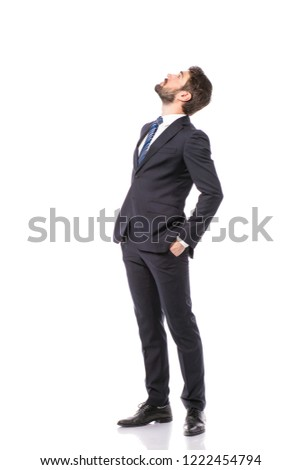 corporate man, elegant businessman standing on white background pointing and looking up #1222454794