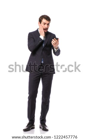 corporate man, elegant businessman standing on white background geting the bad news on cellphone #1222457776