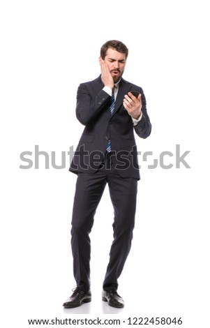 corporate man, elegant businessman standing on white background geting the bad news on cellphone #1222458046