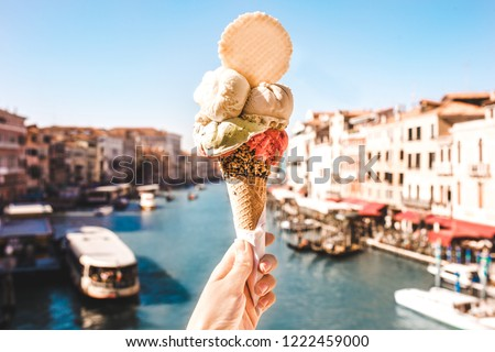 Delicious icecream in beautiful Venezia, Italy in front of a canal and historic buildings #1222459000