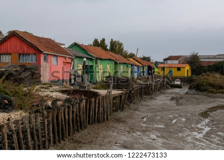France, Island of Oléron, 05/11/2018, Make-shift wooden cabins used for the Oyster Farming Business, some transformed for Artists. A must see location in France.  Located in a old harbour.  #1222473133