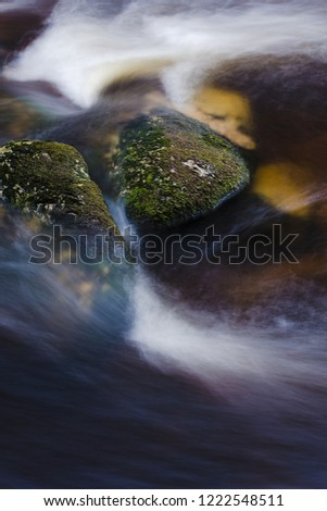 Snowy stone in the water, coming winter, winter weather #1222548511