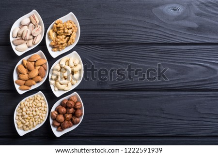 Mix of nuts : Pistachios, almonds , walnuts , pine nut , hazelnuts and cashew . Snack in bowl backgrond #1222591939