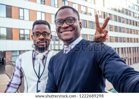 two handsome and young african american men making selfie portrait on smartphone in the airport #1222689298