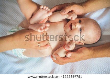 Because care begins in family. Newborn baby given massage by parents. Newborn baby care. Happy parenting. Parenting is challenging. Allow yourself to be a happy parent for child and yourself. #1222689751