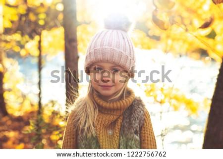 An Autumn portrait of cute blond child girl #1222756762