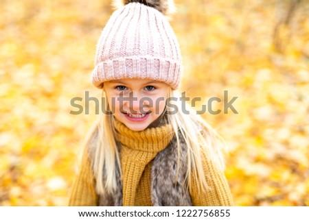 An Autumn portrait of cute blond child girl #1222756855