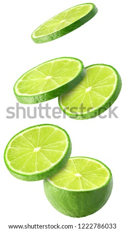 Isolated flying limes. Falling sliced lime fruit isolated on white background with clipping path #1222786033