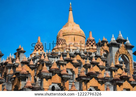 Pink sandstone memorial to commemorate the good deeds of Buddhists at Wat Kung, Roi Et, Thailand Southeast Asia #1222796326