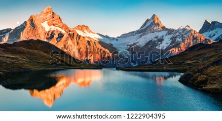 Breathtaking evening panorama of Bachalp lake/Bachalpsee, Switzerland. Exciting autumn sunset in Swiss alps, Grindelwald, Bernese Oberland, Europe. Beauty of nature concept background. #1222904395
