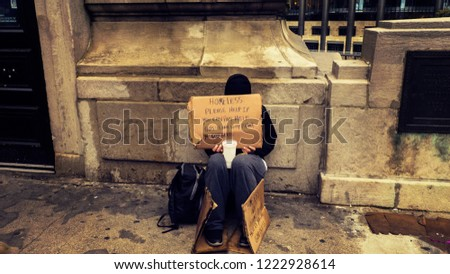 Homeless Person Begging On A Dirty Urban Street in Large City #1222928614