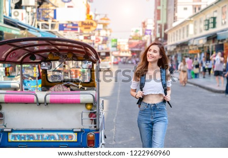 Young Asian traveling women traveling backpacker in Khaosan Road at Bangkok Thailand, traveler and tourist concept.