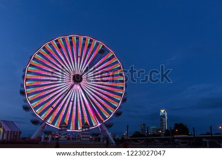 OCTOBER 11, 2018 - Oklahoma City, USA at dusk - we see ferris wheel and Oklahoma City Skyline, Oklahoma City, Oklahoma