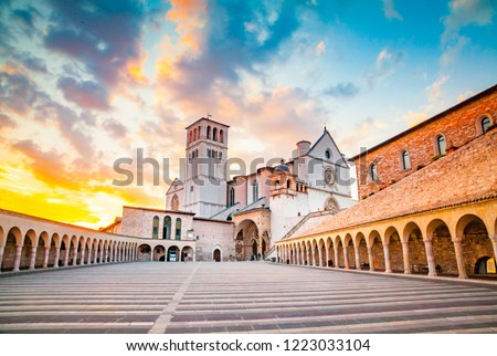 Famous Basilica of St. Francis of Assisi (Basilica Papale di San Francesco) with Lower Plaza at sunset in Assisi, Umbria, Italy #1223033104