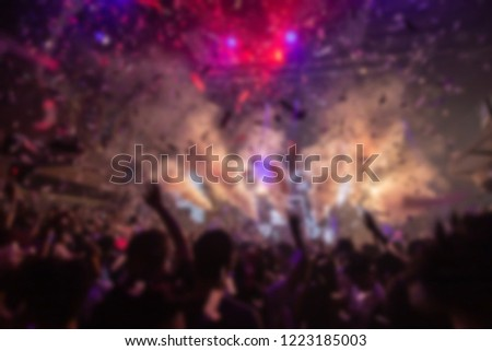 Effects blur Concert, disco dj party. People with hands up having fun  #1223185003
