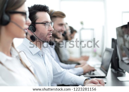 close up.background image of call center employees in the workplace #1223281156