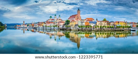 Panoramic view of the historic city of Passau reflecting in famous Danube river in beautiful evening light at sunset, Bavaria, Germany #1223395771