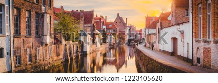 Panoramic view of the historic city center of Brugge in beautiful golden morning light at sunrise, province of West Flanders, Belgium #1223405620