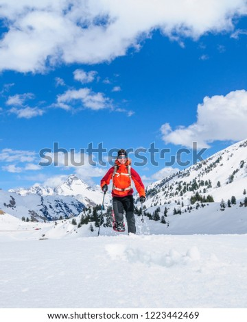 man in nature doing a hiking tour in snow #1223442469