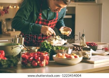 Man preparing delicious and healthy food in the home kitchen for christmas (Christmas Duck or Goose) #1223454004