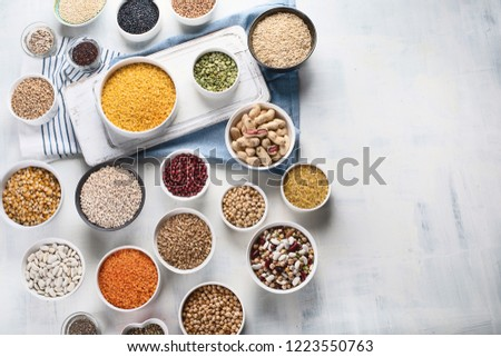 Various grain, cereals, seeds, beans. Top view with copy space #1223550763