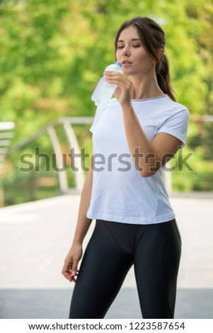 Woman drink after exercise workout in gym fitness training sport healthy lifestyle bodybuilding, #1223587654