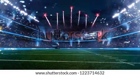 Empty American fotball field. celebrate win or touchdown. focus in grass. little unfocus in background #1223714632