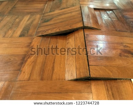 Damaged parquet floor because of humidity and moisture, bending and come out, image captured by smartphone Royalty-Free Stock Photo #1223744728