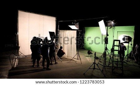 Low key silhouette lighting of VDO production behind the scenes which film crew team are setting up camera and set for shooting and waiting for movie director okay with the scenes in monitor. #1223783053