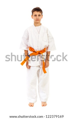 Boy in a kimono with orange belt isolated over white background #122379169